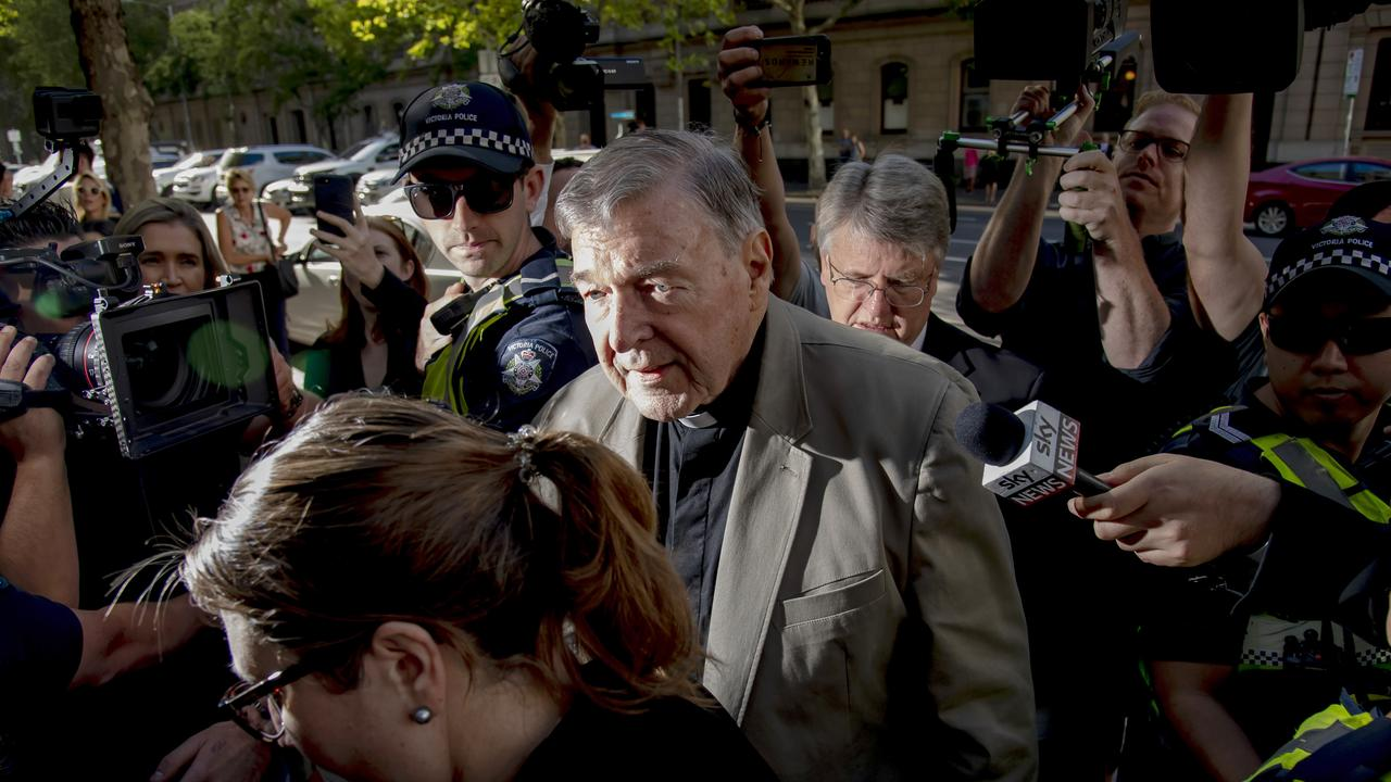 Cardinal George Pell arrives at the County Court in Melbourne on Wednesday. Picture: Andy Brownbill