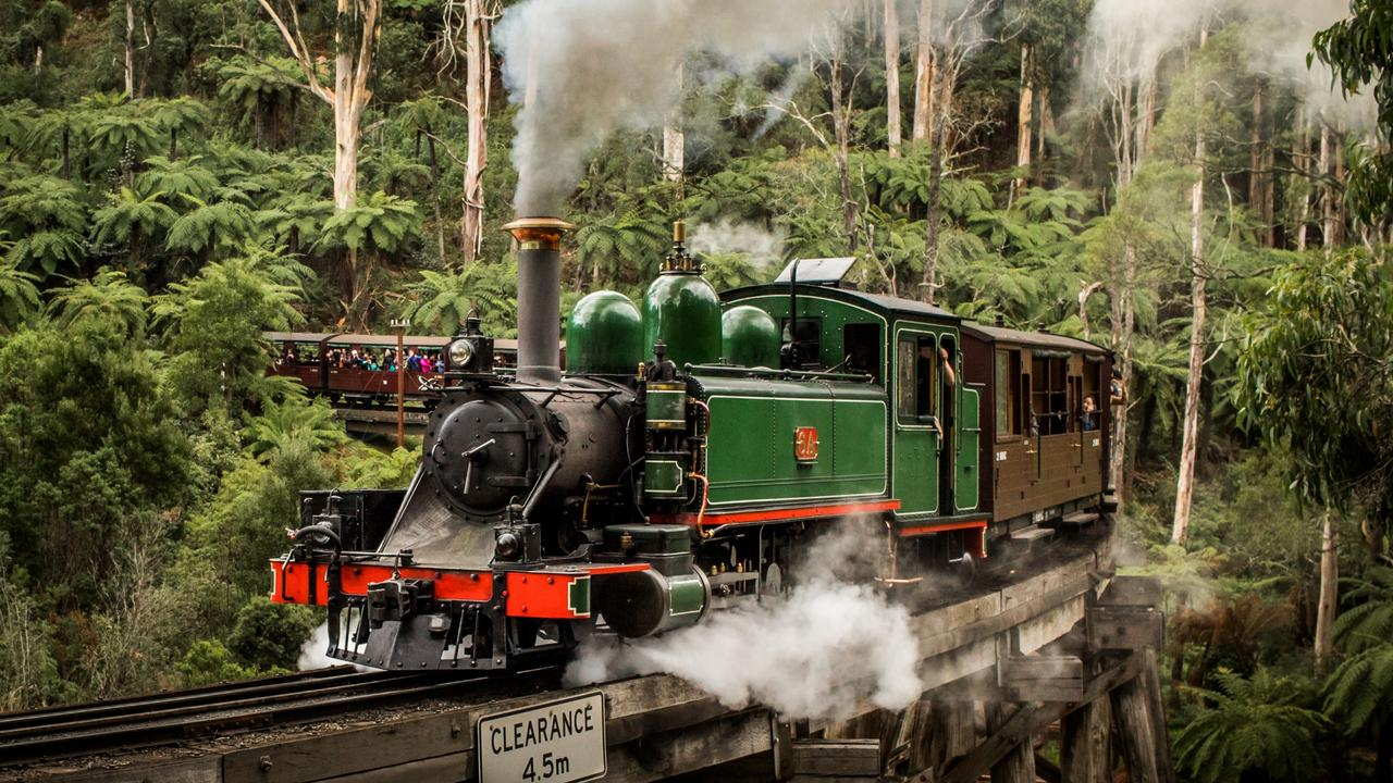 Puffing Billy travels over the trestle bridge.