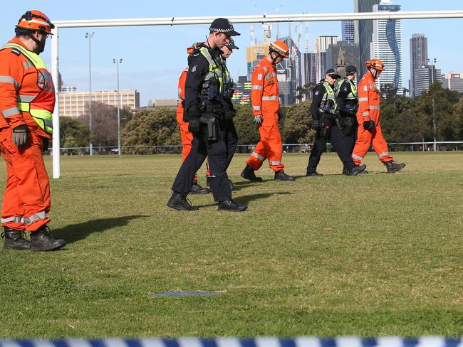 Police and SES conduct a line search of the area. Picture: David Crosling