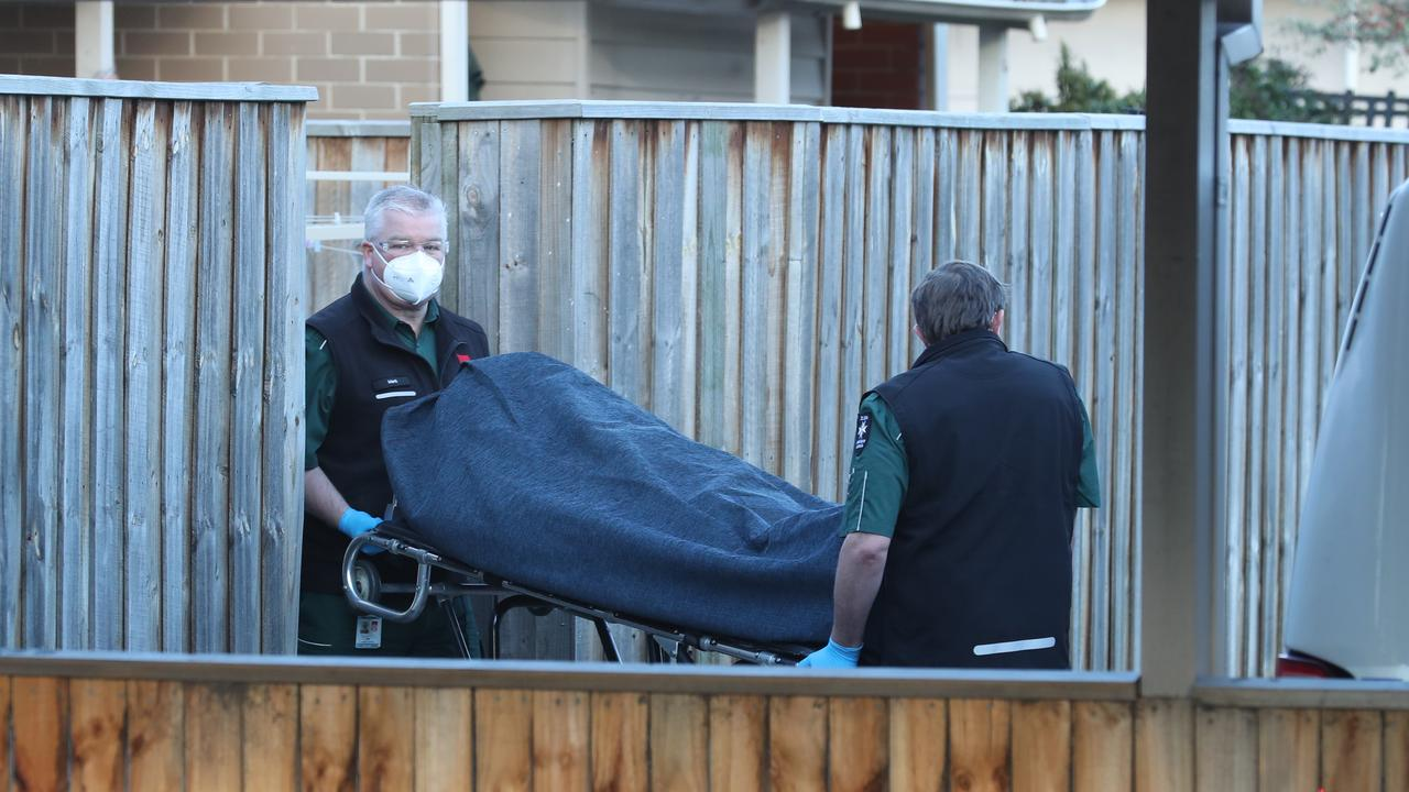Coroner staff take the man's body away from the Frankston home. Picture: David Crosling