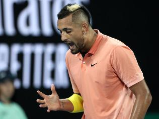 MELBOURNE, AUSTRALIA - JANUARY 23: Nick Kyrgios of Australia reacts during his Men's Singles second round match against Gilles Simon of France on day four of the 2020 Australian Open at Melbourne Park on January 23, 2020 in Melbourne, Australia. (Photo by Hannah Peters/Getty Images)