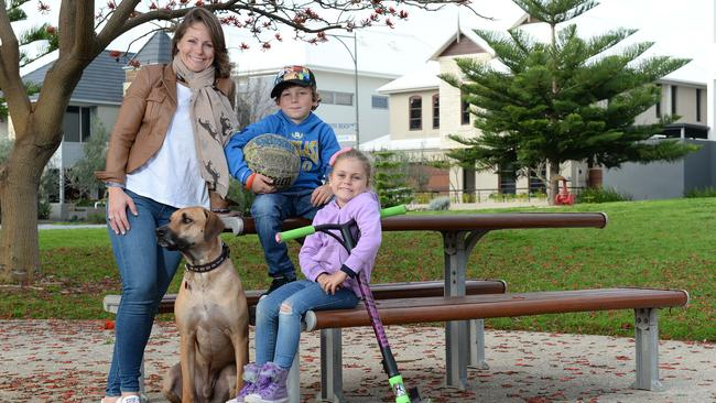 North Coogee resident Lucy Gibson with children Nathan, 8, and Annabelle, 5, and their dog Max. The last Census revealed their suburb is the fastest growing.
