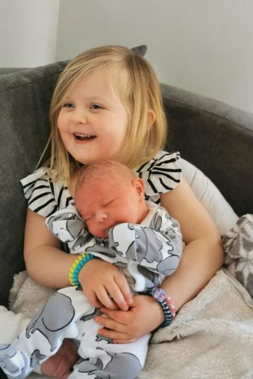 MERCURY PRESS. Pictured: Erin, 4, with her baby brother, Roman. A mum has shared a heartbreaking warning to other parents after her seemingly 'perfect' and healthy baby who never cried turned out to have a fatal genetic disorder. Laura Dinnen, 29, from Acomb, York, never imagined that her baby boy, Roman's 'chilled out' disposition would turn out to be a symptom of a deadly metabolic disorder which took his life just days after he was born in April. The mum of one who has a daughter, Erin, four, with her husband, Andrew, 34, enjoyed a stress-free pregnancy and birth, and believed they'd struck lucky with a quiet and relaxed newborn who wouldn't cry when he was put down or had his nappy changed. SEE MERCURY COPY