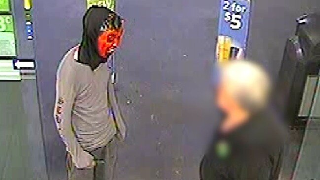 Queensland cops on the hunt for man in Halloween mask