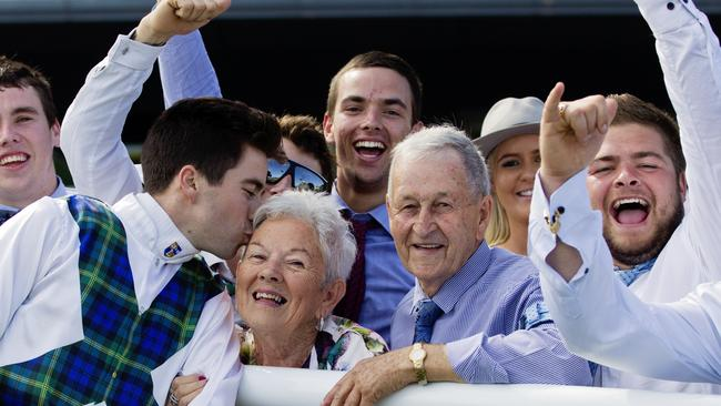 Winning jockey Adam Hyeronimus gives his nan a kiss after Red Excitement won the Summer Cup at Royal Randwick. Picture: Jenny Evans
