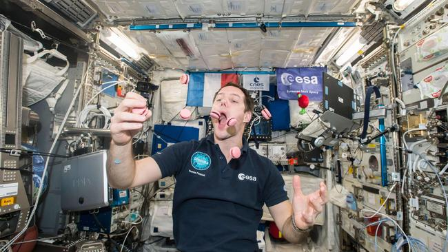 French Austronaut Thomas Pesquet juggling and eating macarons. Exercise in space causes astronauts' bodies to gain heat fast — but is shed very slowly. Picture: NASA via AFP