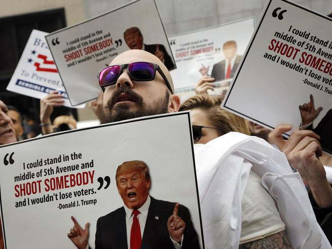 """Protesters, organized by The Brady Campaign to Prevent Gun Violence, stage a """"die-in"""" in front of Trump Tower, the residence of Republican presidential candidate Donald Trump. Picture: AP"""