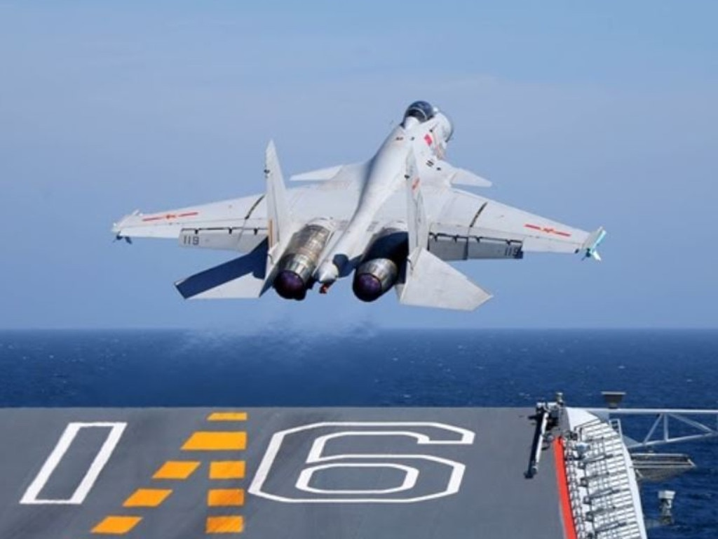A J-15 carrier-borne fighter jet takes off from the flight deck of the aircraft carrier Liaoning during a maritime training exercise. Picture: ChinaMil/PLA
