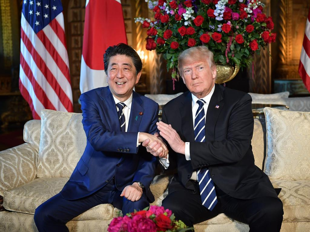 Japan Prime Minister Shinzo Abe shakes hands with then US President Donald Trump at the Mar-a-lago resort in 2018. Picture: AFP / Mandel Ngan