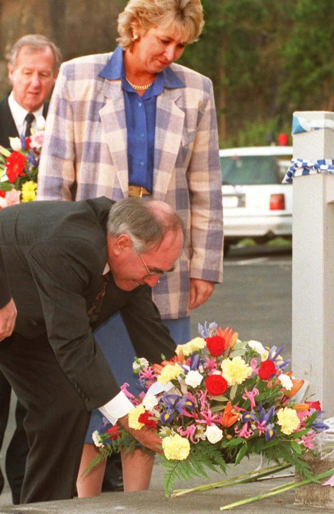 John Howard lays a wreath at the Broad Arrow Cafe at Port Arthur in 1996.