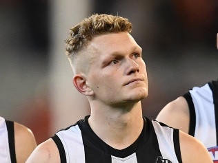 MELBOURNE, AUSTRALIA - SEPTEMBER 21: Jaidyn Stephenson, Adam Treloar and Ben Reid of the Magpies look dejected after losing the AFL Preliminary Final match between the Collingwood Magpies and the Greater Western Sydney Giants at the Melbourne Cricket Ground on September 21, 2019 in Melbourne, Australia. (Photo by Quinn Rooney/Getty Images)