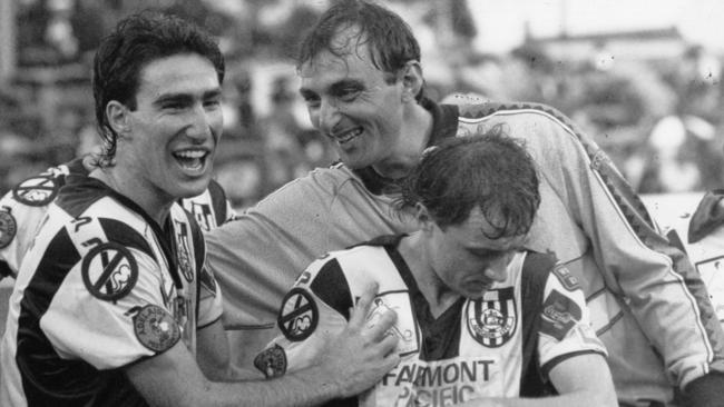 Adelaide City goalkeeper Robert Zabica celebrates winning the 1992 National Soccer League Cup with teammates Tony Vidmar and Ernie Tapai.