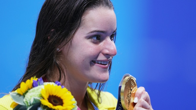 TOKYO, JAPAN - JULY 27:  Kaylee McKeown of Team Australia poses with the gold medal after winning the Women's 100m Backstroke Final on day four of the Tokyo 2020 Olympic Games at Tokyo Aquatics Centre on July 27, 2021 in Tokyo, Japan. (Photo by Maddie Meyer/Getty Images)