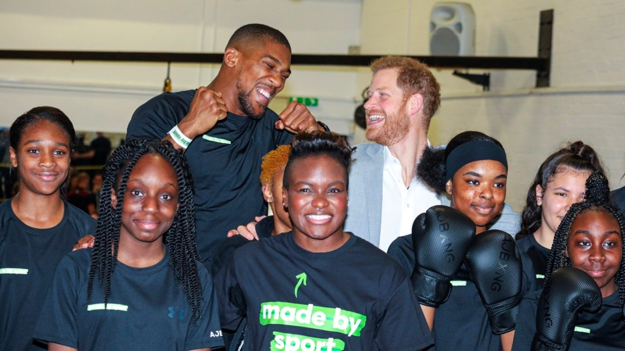 Prince Harry in the ring with former heavyweight world champion