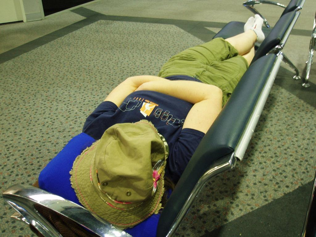 A traveller discovers a rare spot to stretch out at Perth Airport. Picture: Amanda Slater / Flickr