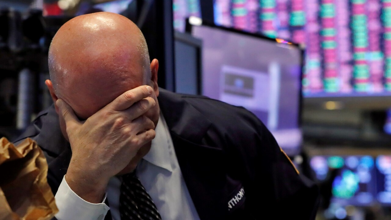 Wall St halts trading for third time in a week as market plunge continues
