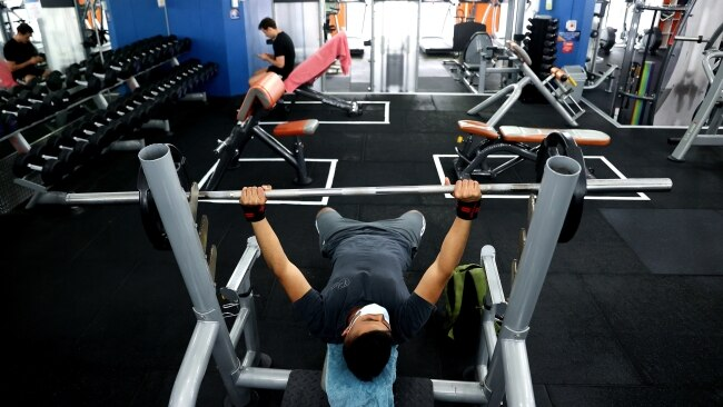 A man lifts weights at Plus Fitness Gym in Darlinghurst as gyms reopened on Monday. Picture: Brendon Thorne/Bloomberg via Getty Images