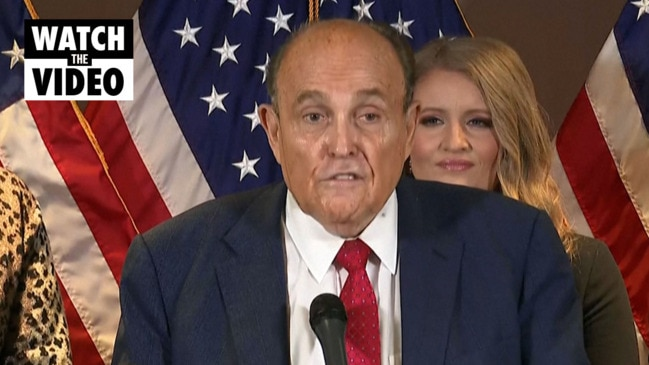 Moment Rudy Giuliani's hair dye runs down his face during press conference