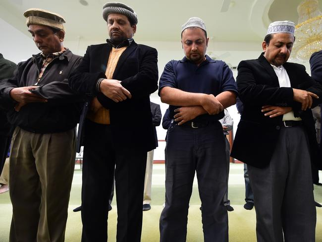 Bridging divides ... Muslims at the Baitul Hameed Mosque in Chino, California in a prayer vigil to commemorate lives lost a day after the tragedy in San Bernardino. Picture: Frederic Brown.