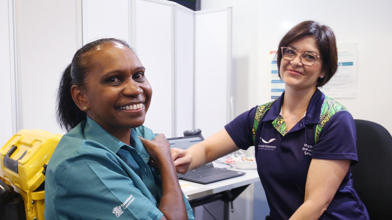 Cairns Hospital Aboriginal and Torres Strait Islander liaison officer for the infection prevention service, Valerie Nancarrow, after receiving a COVID-19 vaccine. Photo: Brendan Radke.
