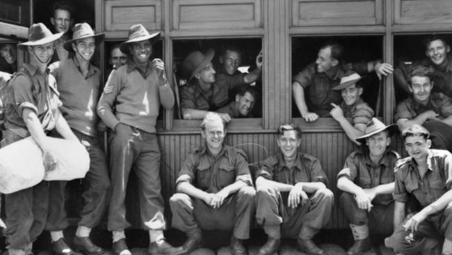 Troops of the 2/7th Infantry Battalion in the carriages and on the station platform waiting for the southbound leave train to start. Picture: Australian War Memorial