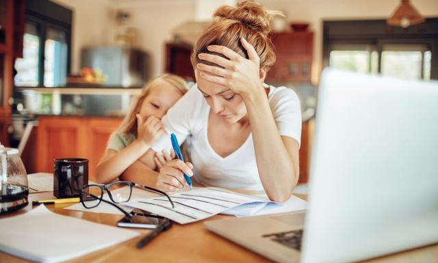 Close up of a mother going through her financials