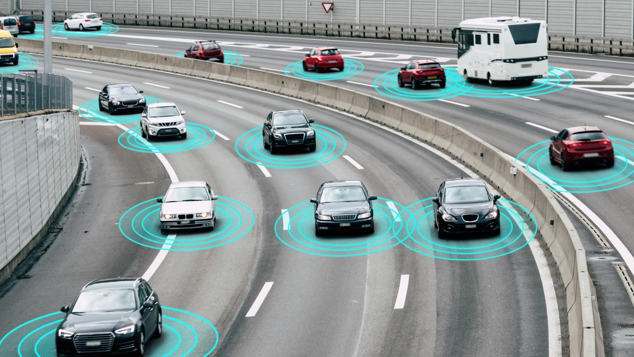 Illustration and photo of autonomous, self-driving cars driving on a highway. The cars are connected through wireless technology and artificial intelligence which enables them to drive on the road safely.