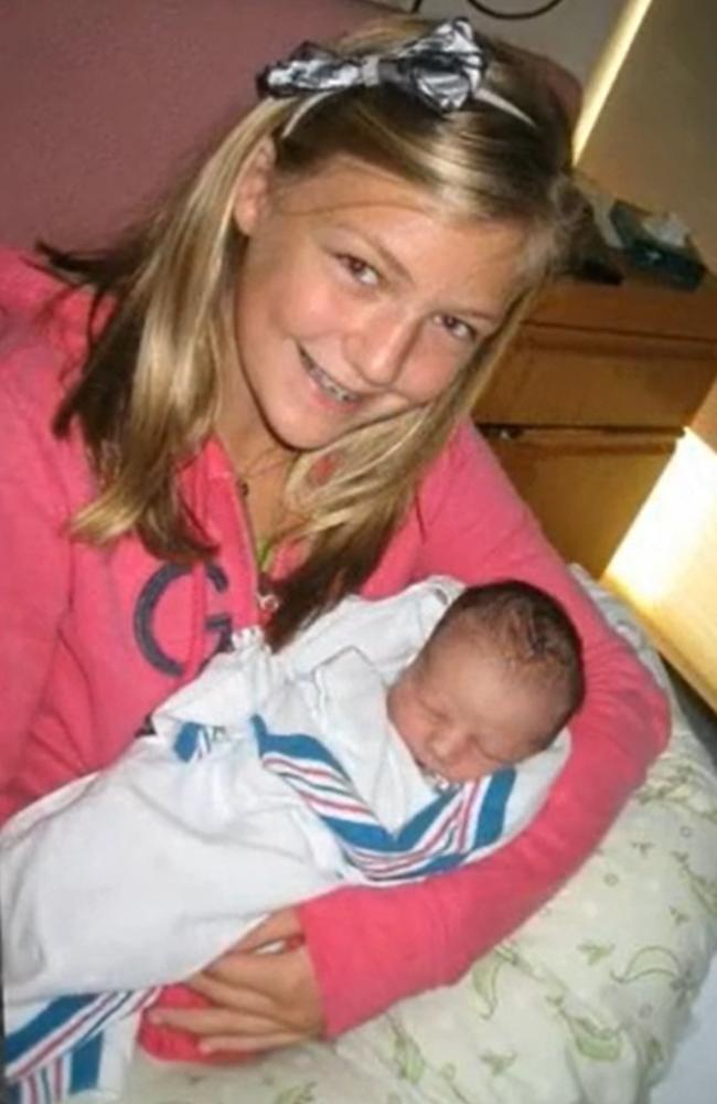 A young Gabby with an infant, possibly one of her half siblings. Picture: Moloney Funeral Home.