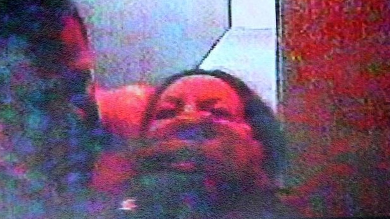 CCTV of Simon Gittany grasping his fiancee Lisa Harnum before murdering her by throwing her off their 15th floor balcony.