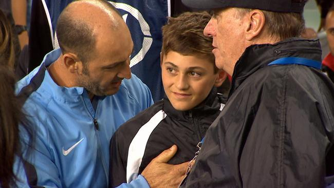 The ball boy will have some story to tell at soccer practice.