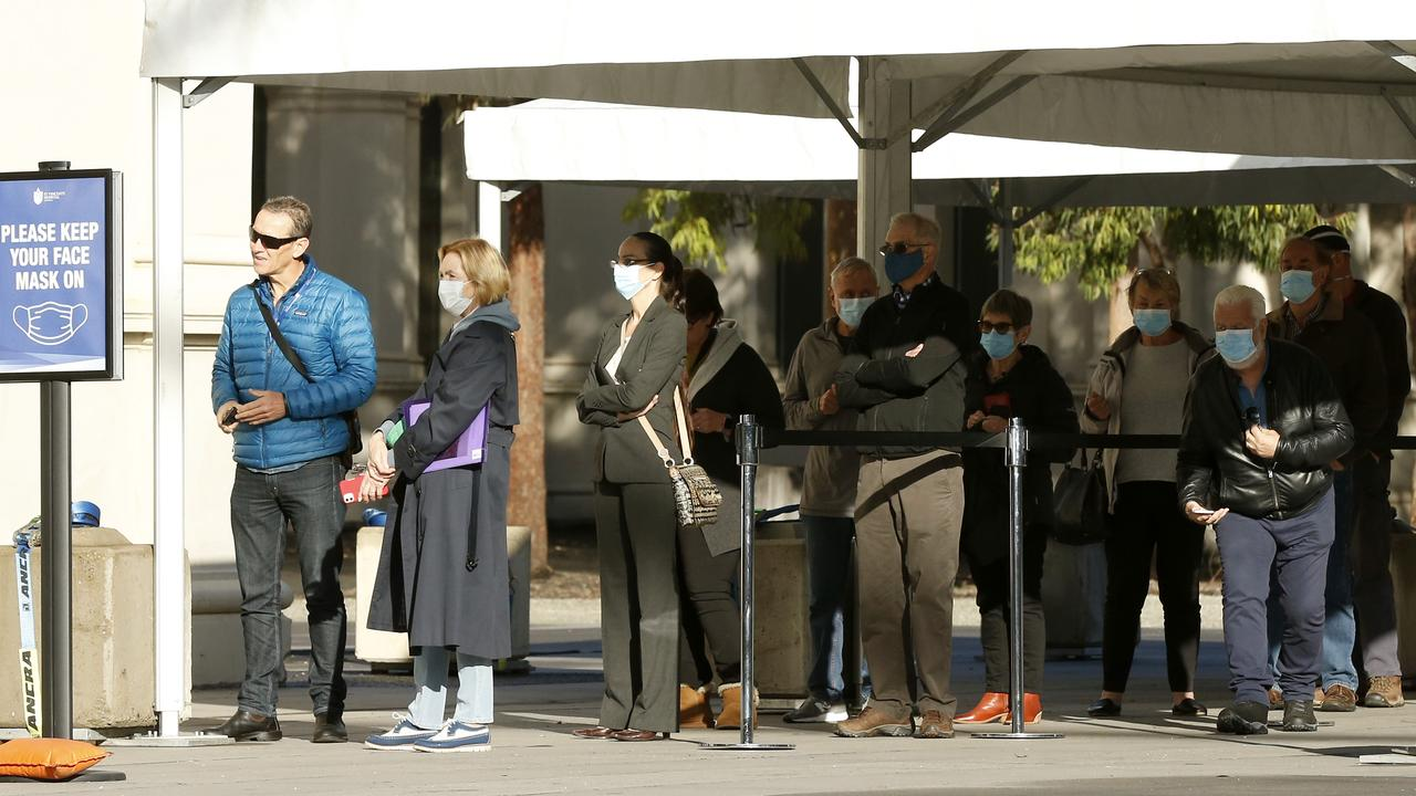 People queue at the mass vaccination hub in Carlton on Wednesday. Picture: Darrian Traynor/Getty Images