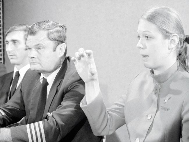 Crew members of the hijacked Northwest Orient Airlines flight explain what happened during a press conference.