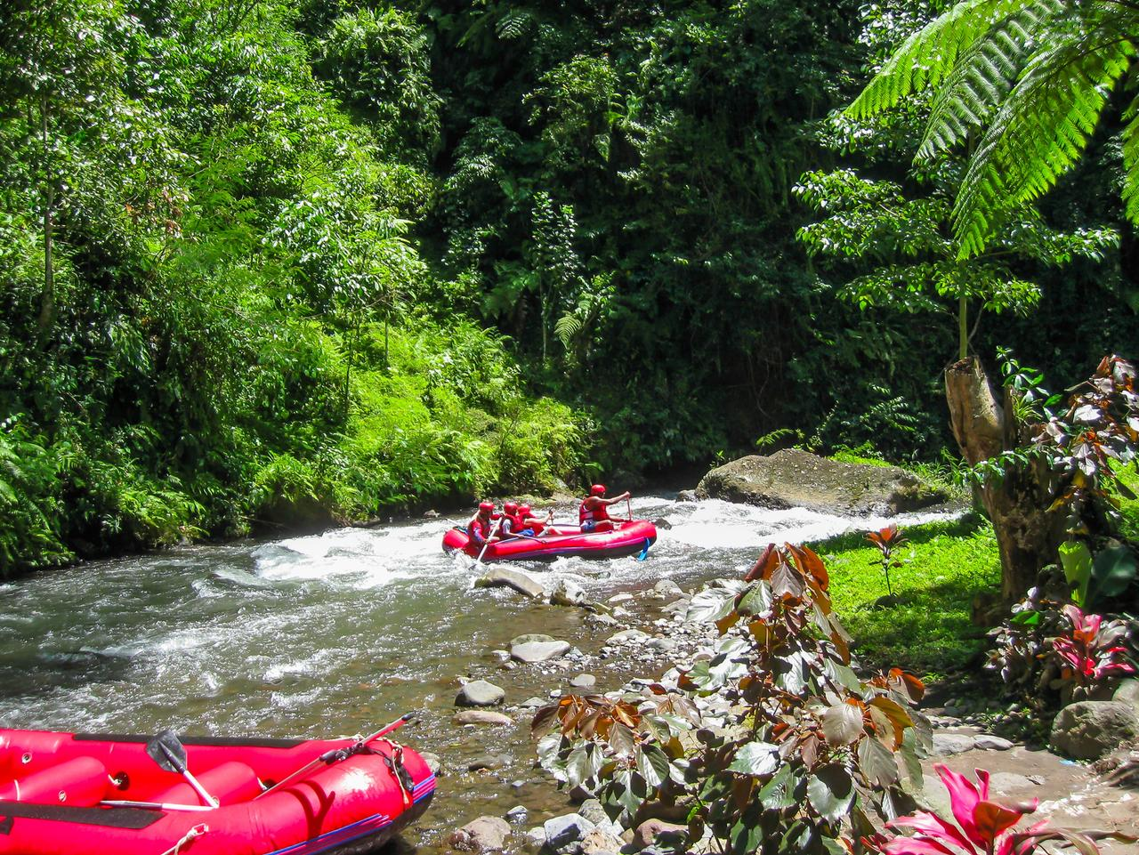 Bali, Indonesia - April 11, 2012: Rafting in the canyon on Balis mountain river