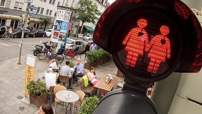 A pedestrian crossing signal showing a lesbian couple at a junction in Munich, Germany. The city introduced the lights following a similar project in the Austrian city of Vienna timed to coincide with a gay and lesbian Pride march. Picture: Joerg Koch/Getty Images.