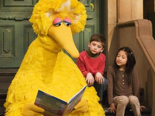 Big Bird reads to Connor Scott and Tiffany Jiao during a taping of Sesame Street on Thursday, April 10, 2008 in New York. Being Big Bird is sweaty, physical work. But puppeteer Caroll Spinney, who has worked on Sesame Street for nearly four decades playing both Big Bird and Oscar the Grouch, has no wish to be anywhere else. (AP Photo/Mark Lennihan)