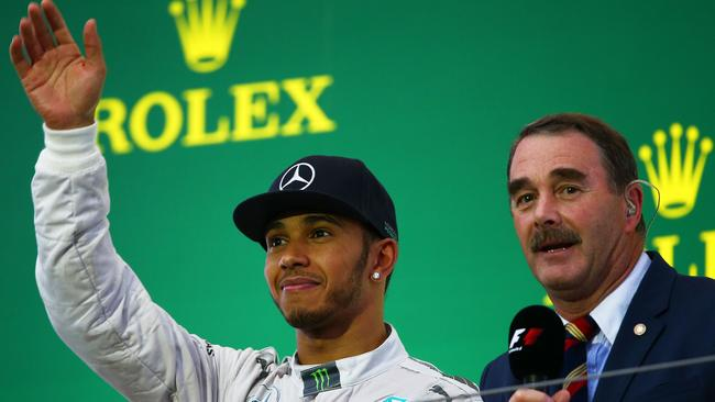 Lewis Hamilton and Nigel Mansell on the podium together in 2014.