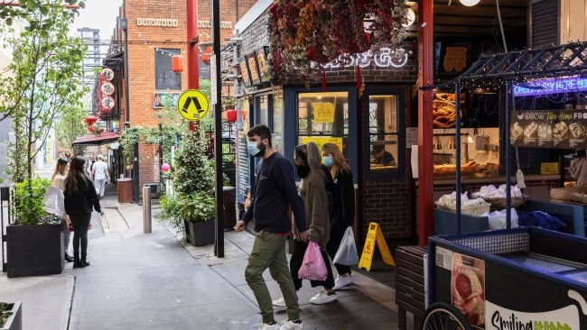 Shoppers are seen in Burwood in Sydney's inner west as hospitality venues reopen across the state. Picture: Brook Mitchell/Getty Images