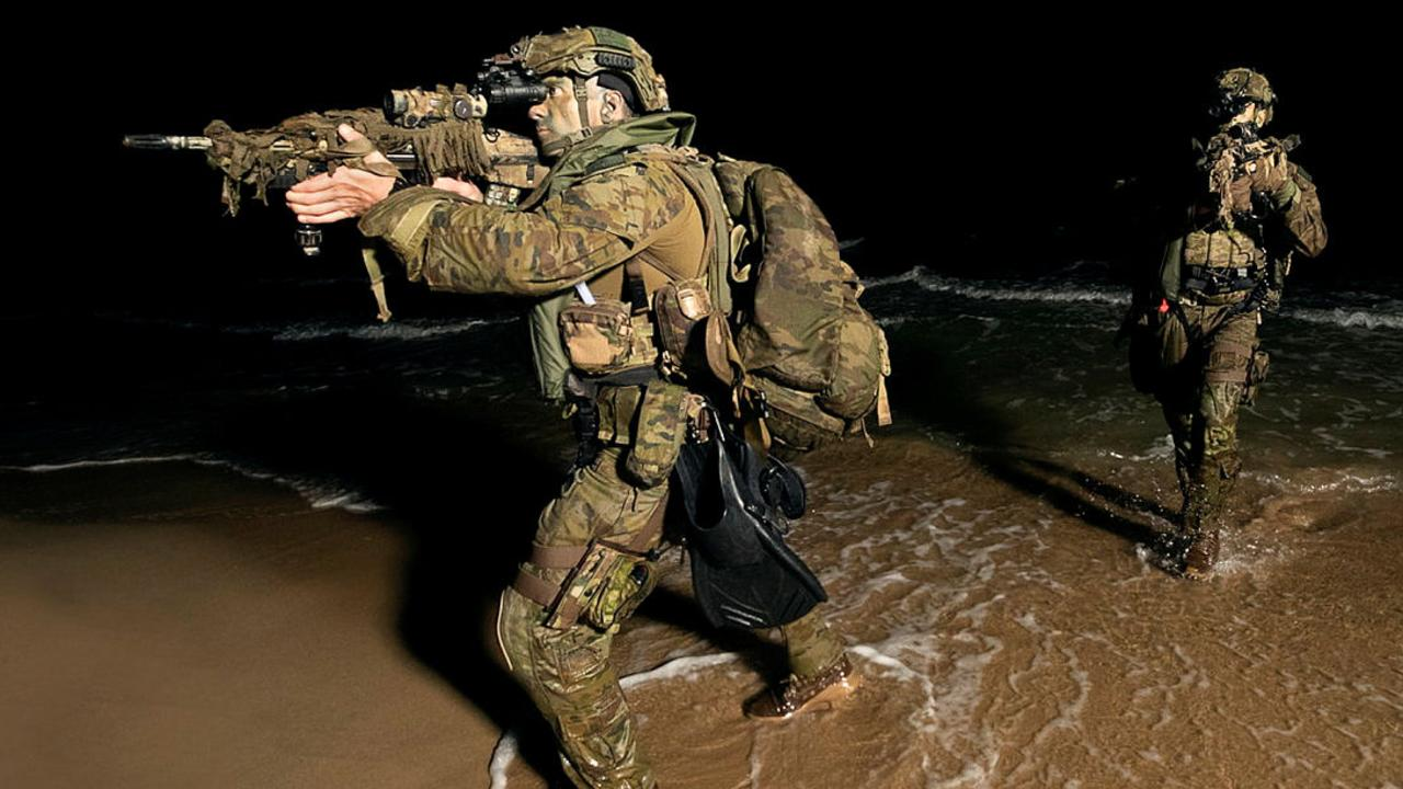 Private Zachary Swander (left) from 2nd Battalion, The Royal Australian Regiment, scans the beach front during a night assault swim insertion at the Cowley Beach Training Area, North Queensland, as part of a simulated Amphibious Ready Group in North Queensland from 18-22 November 2019. PICTURE: ADF/SUPPLIED.