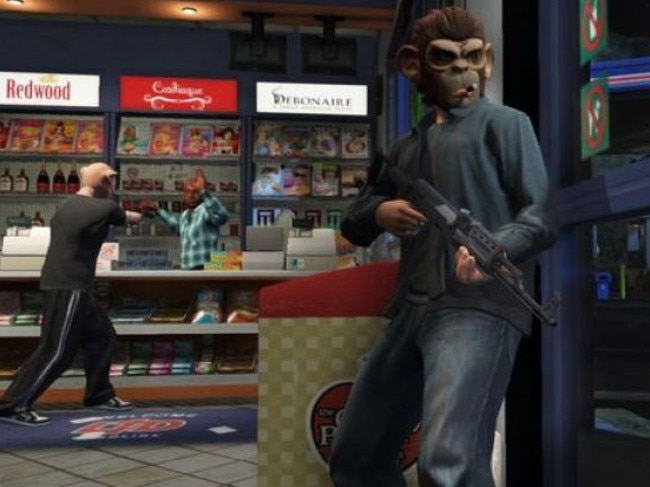 """Just a game? ... Players hold up a gas station in GTA5. Lovers of the game say the petitioners should leave their """"innocent hobby"""" alone."""