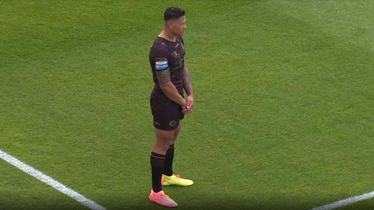 Israel Folau stands up during the moment of reflection