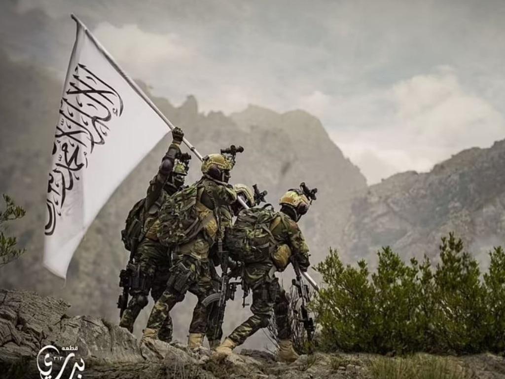 Badri 313 Battalion members of the Taliban hoisting a Taliban flag. Picture: Taliban