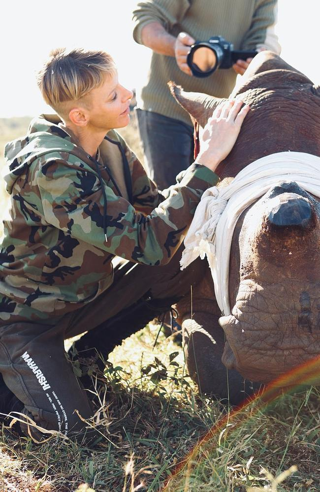 Charlene posed with a rhino which had had its horn removed to prevent poaching. Picture: Christian Sperka