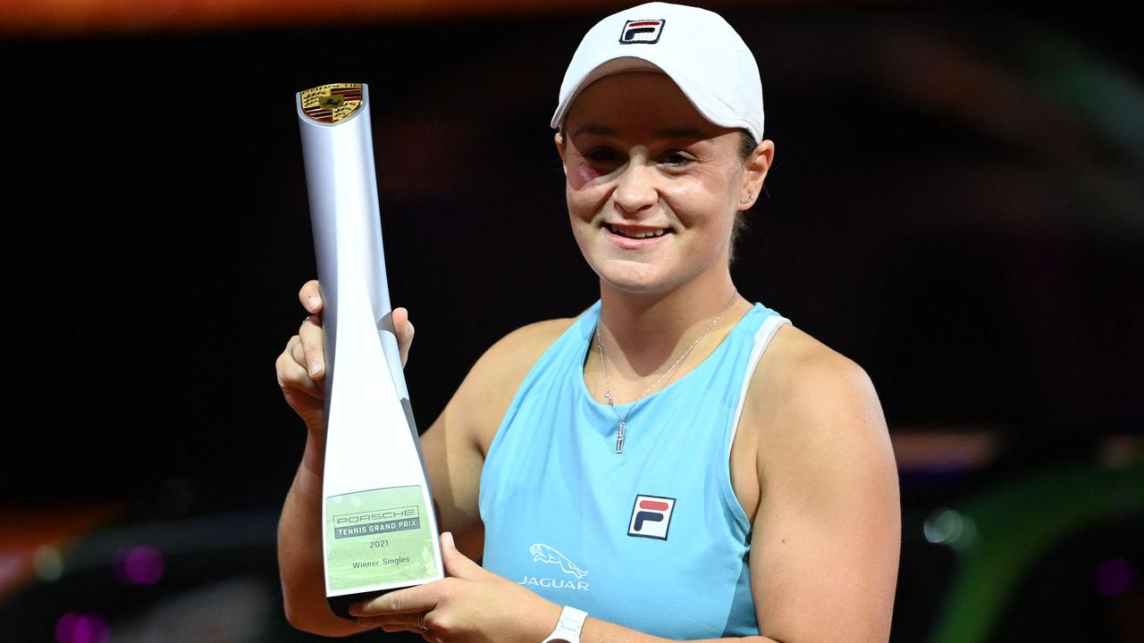 Ash Barty poses with her trophy after winning the singles final match . (Photo by Marijan Murat / POOL / AFP)
