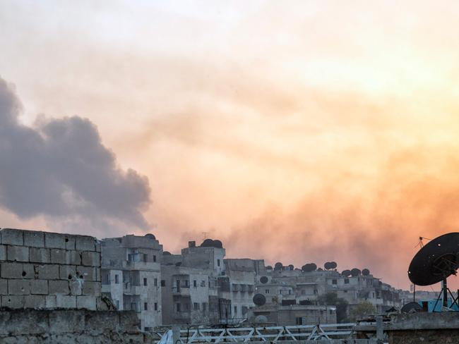 Smoke billows from the frontline district of Dahiyet al-Assad following an attack by rebels on Syrian regime forces in the northern city of Aleppo on October 29. Picture: AFP / Karam Al-Masri