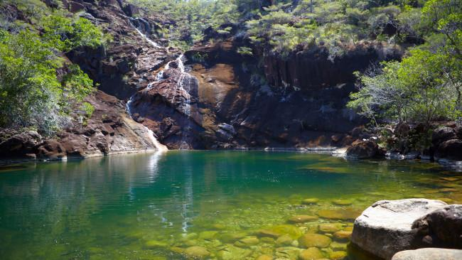 11/11Zoe Falls, Hinchinbrook Island, QldYou'll need grit to reach one of the world's most remote natural infinity pools. Found after a sweaty hike through the Jurassic landscape of Hinchinbrook Island, north of Townsville, swimming in this rockpool with vistas stretching to the Great Barrier Reef is a rite of passage for anyone tackling the 32km Thorsborne Trail. But if you're not into schlepping it too hard for your swim reward, Walk into Luxury offers a five-hour hosted experience by private boat charter. Picture: Tourism Australia See also:- I found Australia's best swimming spot- Incredible ocean pools in NSW