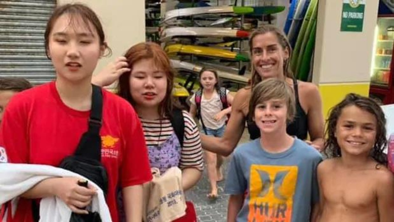The two Korean tourists thanked their rescuers after they were saved by Glenelg Surf Life Saving Club nippers, including Angus Ganley, 11, Astin Rouvray, 11.