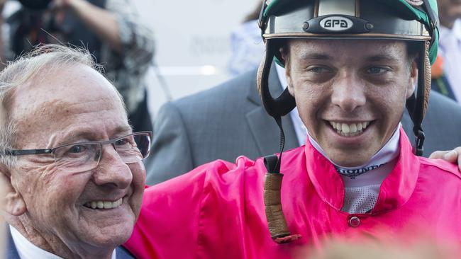 Trainer Ron Quinton and jockey Andrew Adkins celebrate Daysee Doom's win in the Coolmore Classic. Picture: AAP