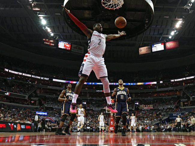 John Wall of the Washington Wizards scores against the Indiana Pacers.