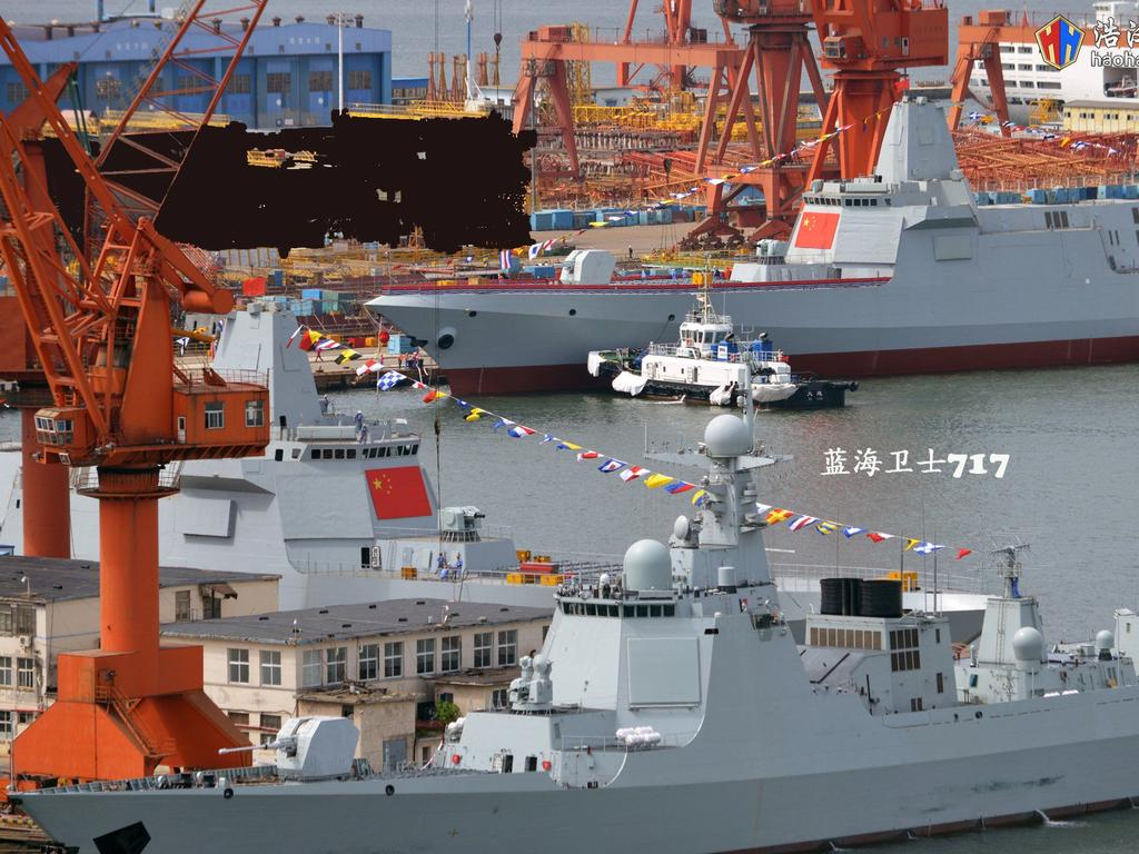The two new Type 055 destroyers China says will be armed with next-generation electromagnetic rail guns.