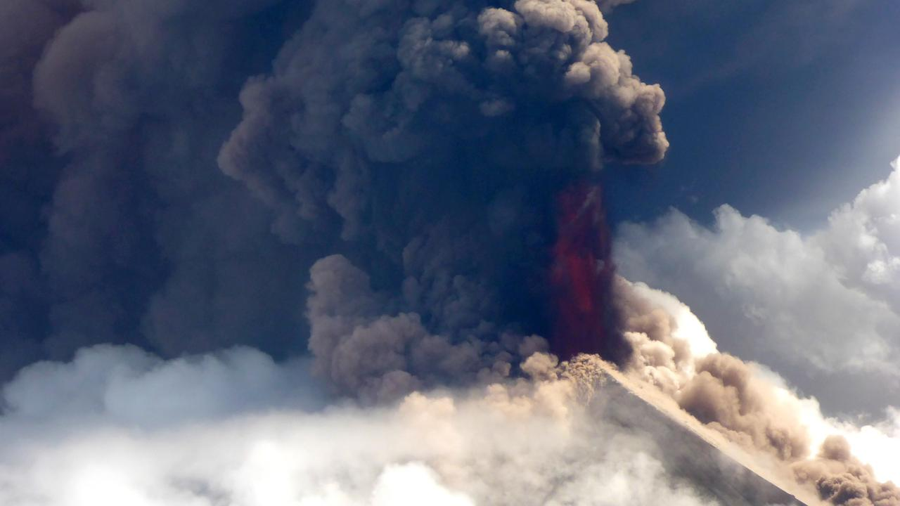 Papua New Guinea's Mt Ulawun volcano spewing lava, as from a helicopter, taken on June 26. Picture: AFP/Craig Powell/Niugini Helicopters